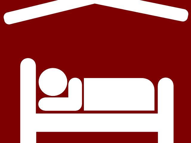 """Logo d'une personne dormant sur un lit pour illustrer l'article de blog """"Quels sont les recours contre l'hôteliers"""""""